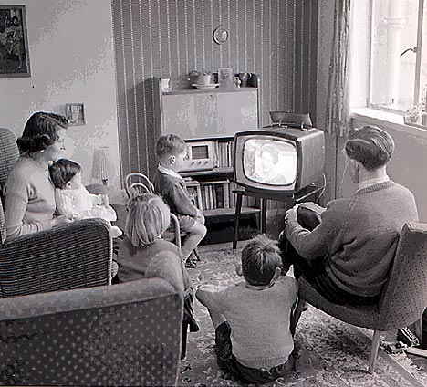 family around tv waiting for 12th Doctor announcement perhaps?