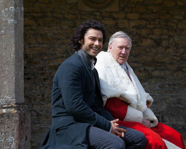 Poldarks, Aidan Turner and Robin Ellis, sharing a brief moment during filming