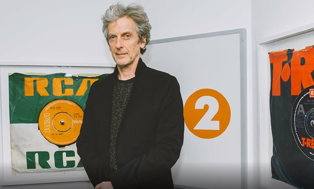 Peter Capaldi opens the TARDIS door to make way for 13th Doctor