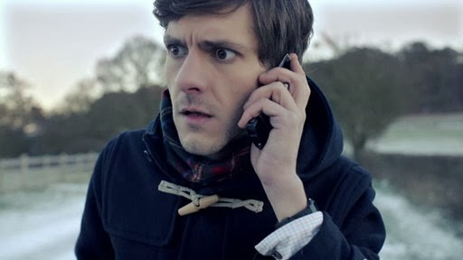 Mathew-Baynton-answers-a-phone-that-will-change-his-life-in-The-Wrong-Mans
