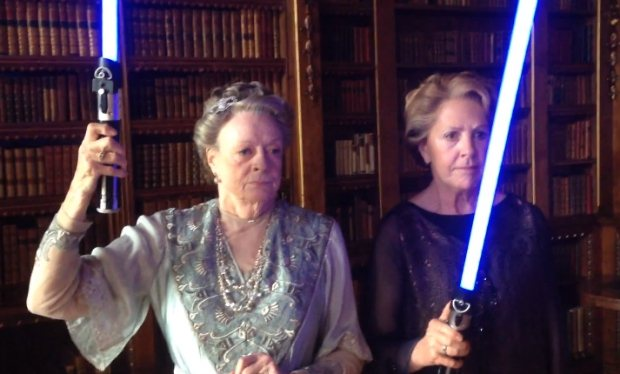 Maggie Smith wielding a lightsaber