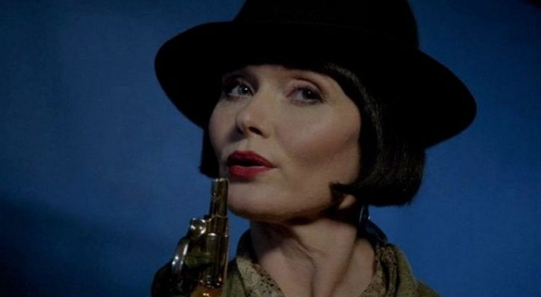 Armed with her pearl-handled Smith & Wesson in one hand and a cocktail the other, the Hon. Phryne Fisher has arrived!